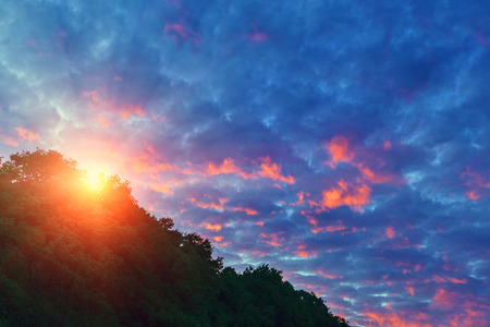 The background of a bright sky with clouds, bright sunset Stock Photo