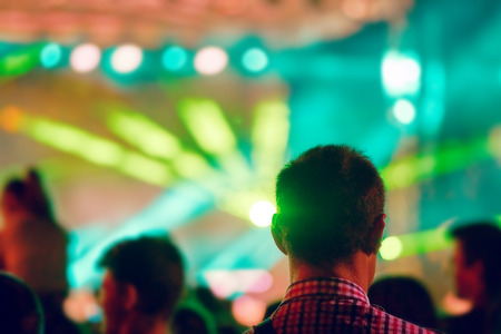 Blurred Youth Music Festival of pop music. Laser show on the stage. The crowd of fans. Bright abstract background ideal for any design. Blurred bokeh basic background for design Stock Photo