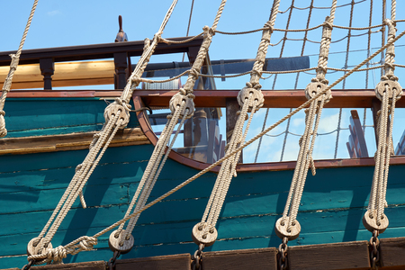 Fragment of deck pleasure craft. Ropes and rope
