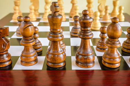 Closeup of Wood Brown and White Chessboard and Pieces; Business Strategy - Concept Stock Photo