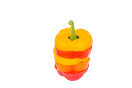 Isolated colorful bell peppers sliced and mixed together.