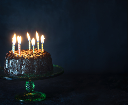 Chocolate cake with lit candles