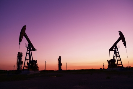 Oilfield drilling rig at sunset, jidong oil field in China   photo