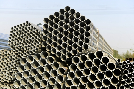bundling: New steel pipes stacked together   Stock Photo