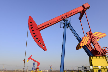 Pumping unit work in the oil field   photo
