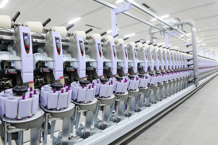 ze: LUANNAN county - December 13: a functioning of spinning equipment is operating within the factory, ze the spinning mill on December 13, 2013, LUANNAN county, hebei province, China.