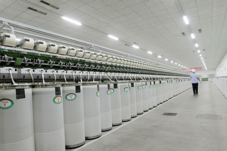 ze: LUANNAN county - December 13: a functioning of spinning equipment is operating within the factory, ze the spinning mill on December 13, 2013, LUANNAN county, hebei province, China.   Editorial