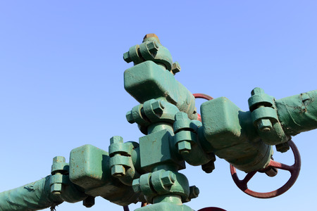 Piping and valves under the blue sky   photo