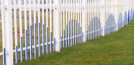 security gap: Beautiful iron fence on the grass