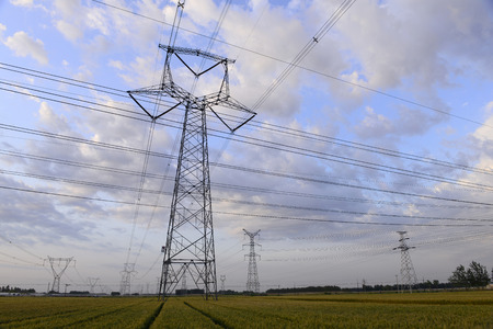 Many of the high voltage towers in the fields photo