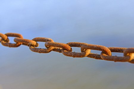 string together: String together a chain of close-up with rust