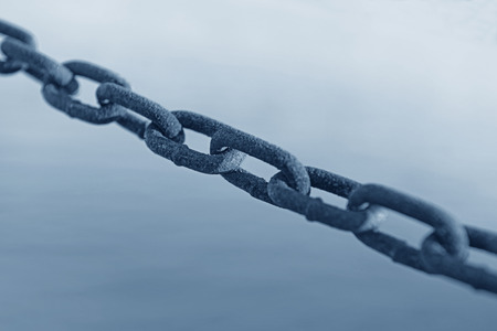 string together: String together a chain of close-up Stock Photo