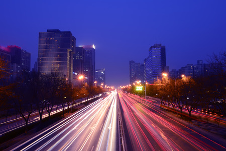 roadside stand: Night roads and tall buildings in Beijing, China