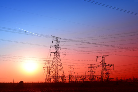 high voltage power towers in the sunset