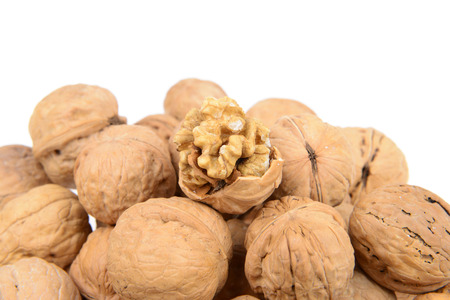 housing lot: Stacked together of walnuts, close-up Stock Photo