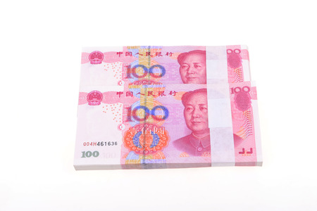bundling: LUANNAN county - March 20: two stacks of new Chinese RMB one hundred on a white background, close-up, March 20, 2015, LUANNAN county, hebei province, China.