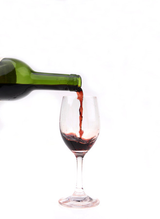 pouring wine: glass with pouring wine, close-up Stock Photo