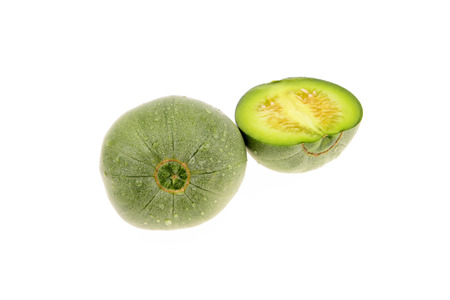 unprocessed: Green melon on a white background Stock Photo