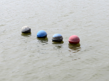 color silence: A few plastic buoy floating on the surface of the water