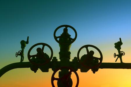 setting  sun: Oil pipeline valve under the setting sun
