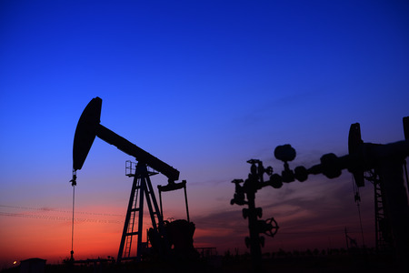 extraction of oil: An isolated operation of pumping unit, in the field of the setting sun