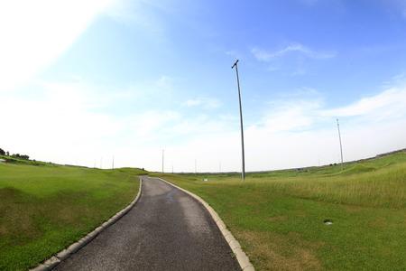 Asphalt roads within the golf course Фото со стока