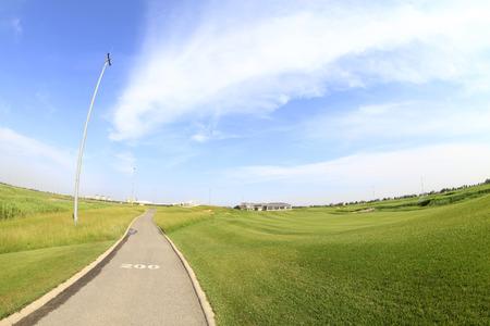 Asphalt roads within the golf course Редакционное