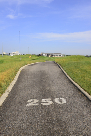Asphalt roads and lawn on the golf course Редакционное