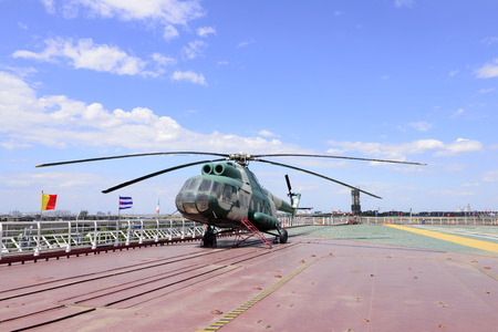 stay in green: The helicopter on the deck of the aircraft carrier
