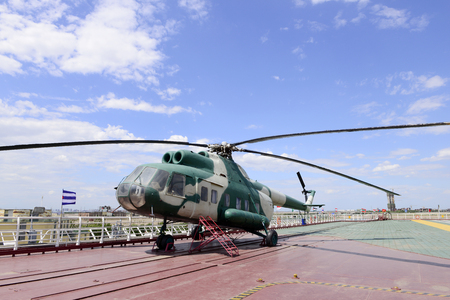 aircraft carrier: The helicopter on the deck of the aircraft carrier