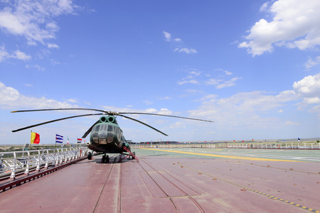 stay in the green: The helicopter on the deck of the aircraft carrier