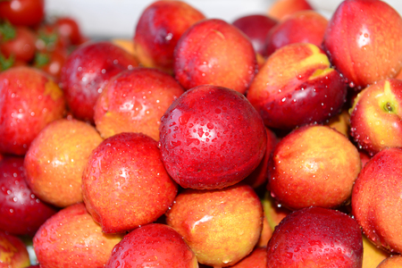 Fresh nectarine together, close-up Stock Photo