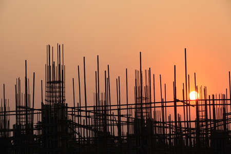 Steel structure buildings under the setting sun  스톡 콘텐츠