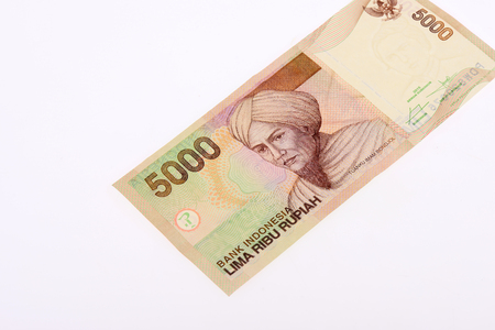 Rupiah note on white background Stock Photo