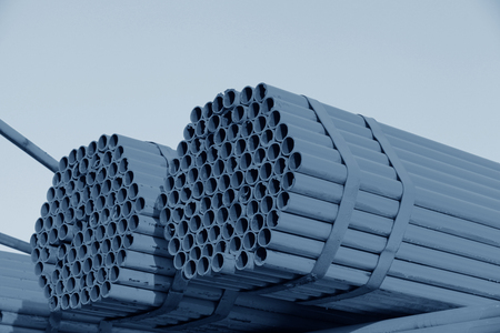 Many steel pipes stacked together