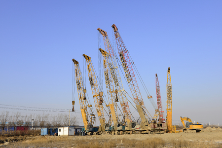 Crawler crane in the construction site