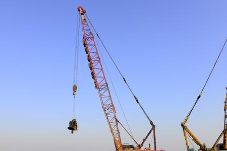 Crawler crane in the construction site