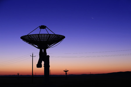 Observatory equipment silhouette at sunrise Stock Photo