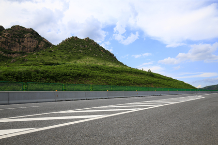 Highway, under the background of blue sky and white clouds