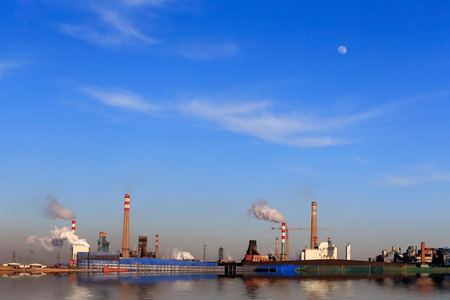 A chemical plant against a blue sky