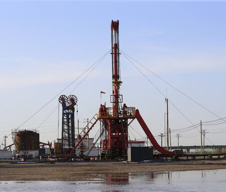 The pumping unit is operating in the oil field in the evening