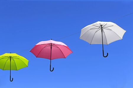 Colorful umbrellas against the blue sky Stockfoto - 131282946