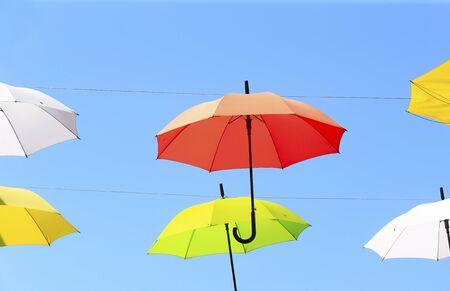 Colorful umbrellas against the blue sky