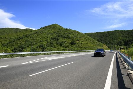 Beautiful highway, under the blue sky and white clouds