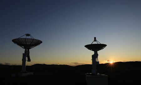 Observatory equipment in the sunset silhouette