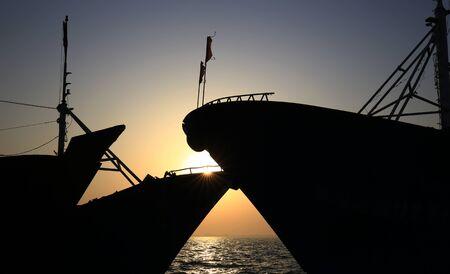 The fishing boats docked at the sea Stock Photo