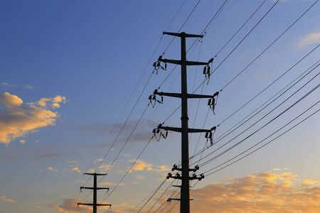 High voltage tower, silhouetted in the evening