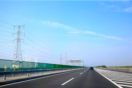 highway under the blue sky and white clouds