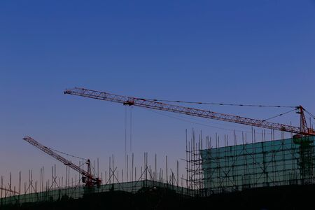 The crane is working at the construction site Archivio Fotografico
