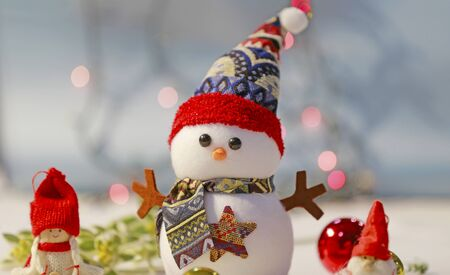 Christmas snowman and light background